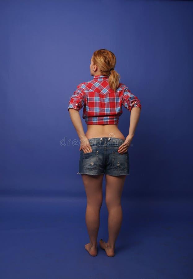 Menina no estúdio da foto foto de stock