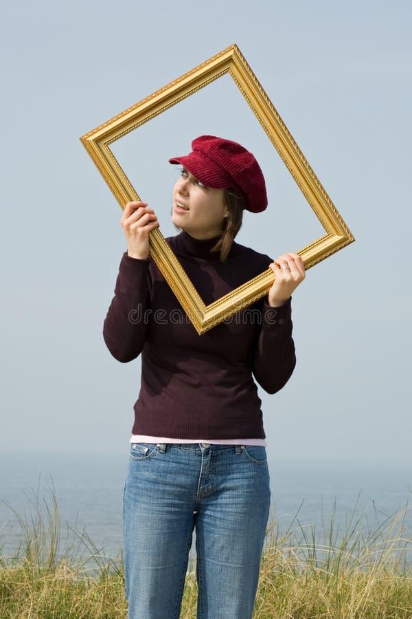 Menina no frame fotografia de stock royalty free