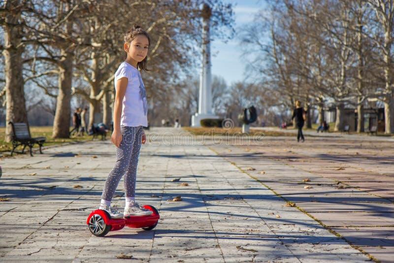Menina no hoverboard imagem de stock royalty free
