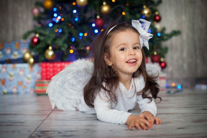 Menina no Natal com uma saia do tutu fotografia de stock royalty free