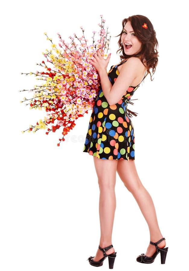 Menina no polca-ponto do vestido e na flor do ramalhete. foto de stock