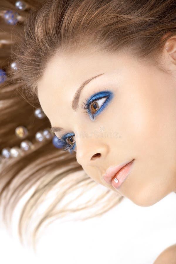 A menina no registo azul imagens de stock royalty free