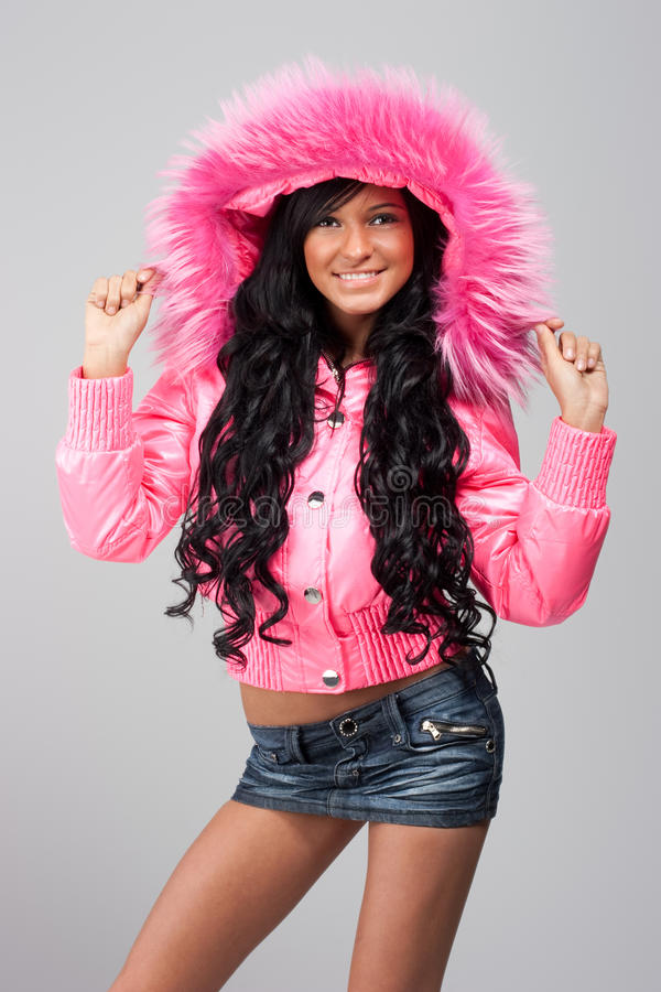 Menina no revestimento cor-de-rosa foto de stock royalty free