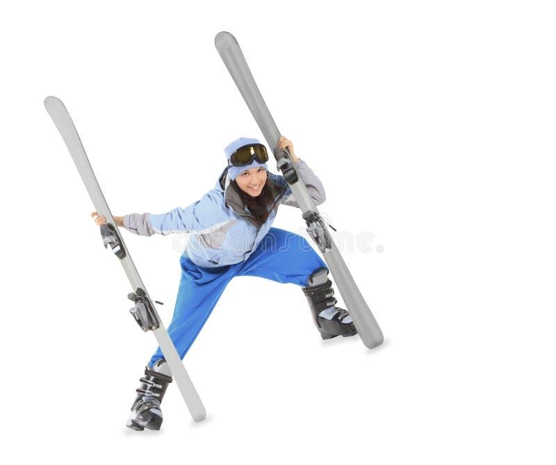 Menina no sportwear com o esqui isolado sobre o branco fotos de stock royalty free