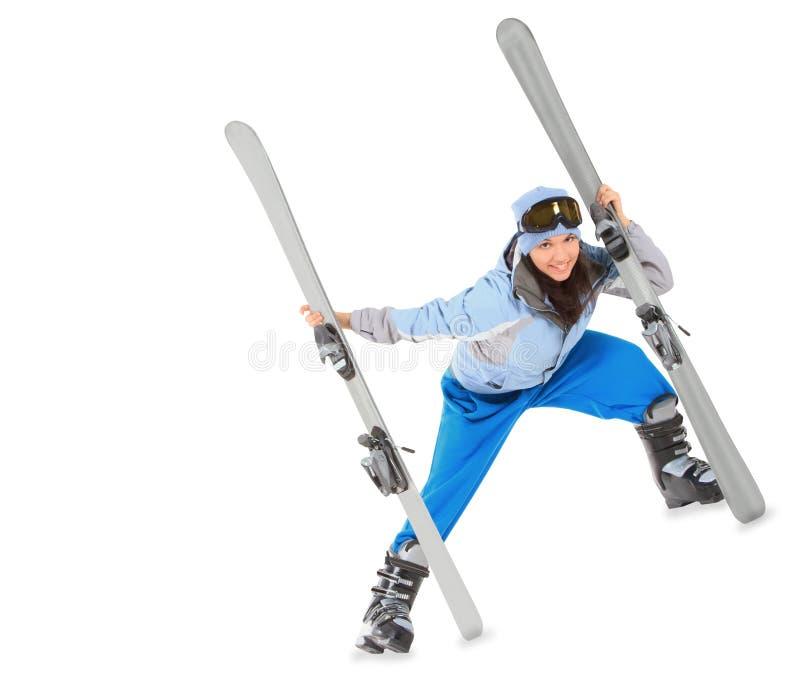 Menina no sportwear com o esqui isolado sobre o branco imagem de stock royalty free