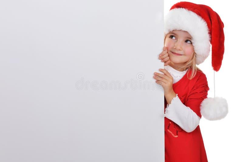 Menina no tampão de Santa foto de stock