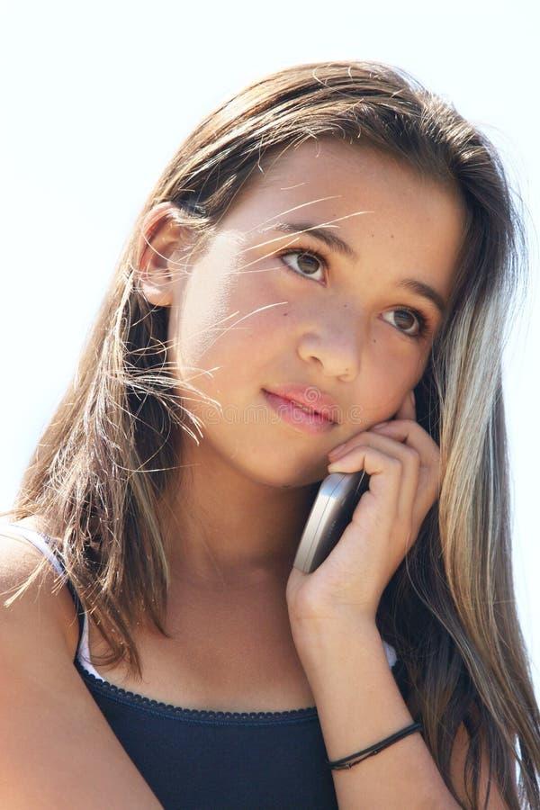 Menina no telefone foto de stock