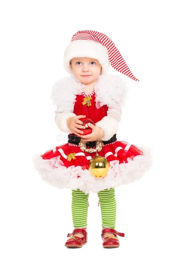 Menina no terno do ajudante de Santa imagem de stock