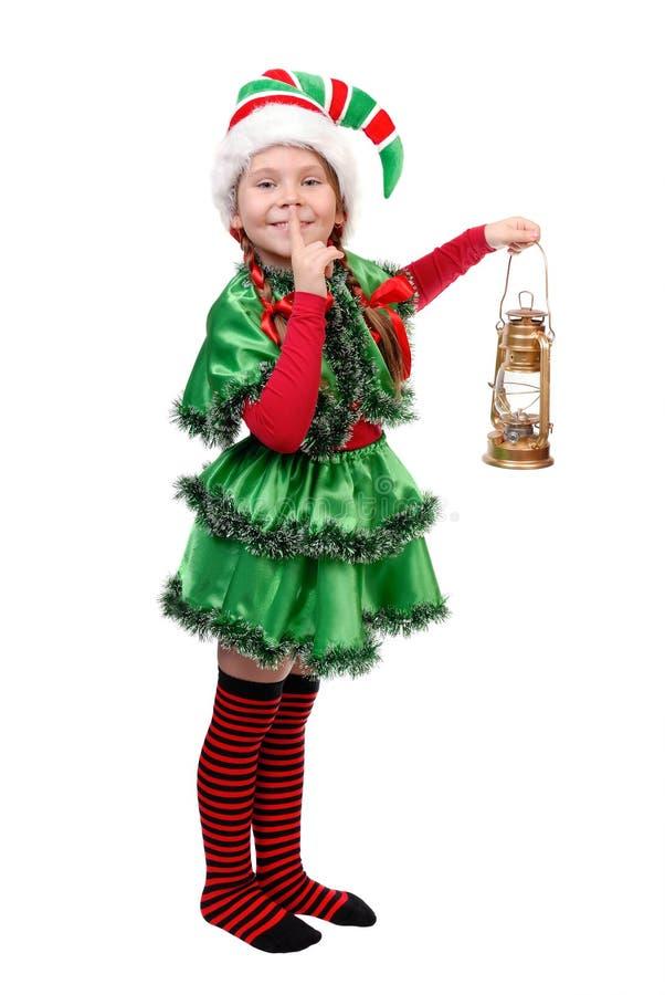 Menina no terno do duende do Natal com lâmpada de petróleo. fotos de stock