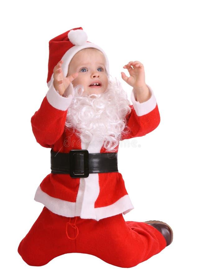 Menina no traje de Papai Noel fotos de stock royalty free