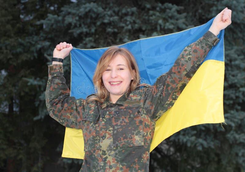 Menina no uniforme militar fotografia de stock