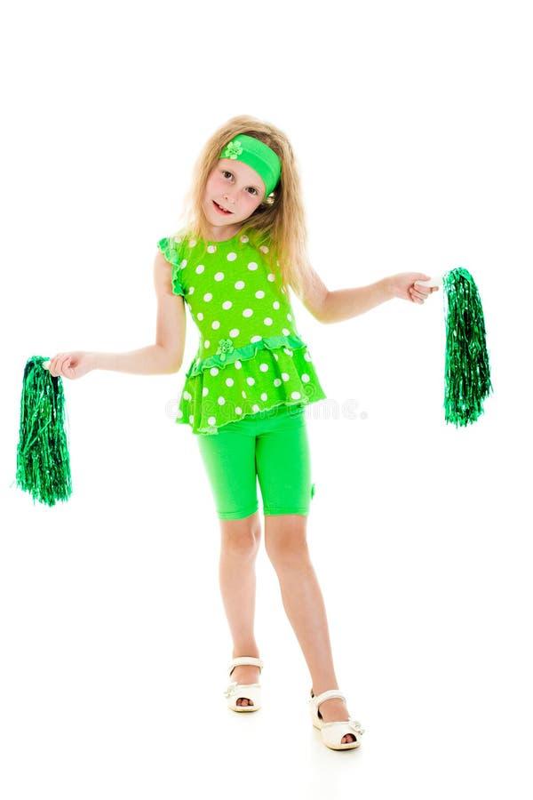 A menina no verde com pompoms. imagem de stock royalty free