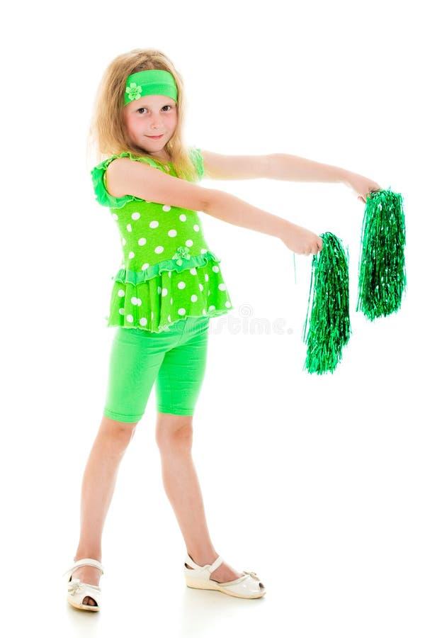 A menina no verde com pompoms. foto de stock royalty free