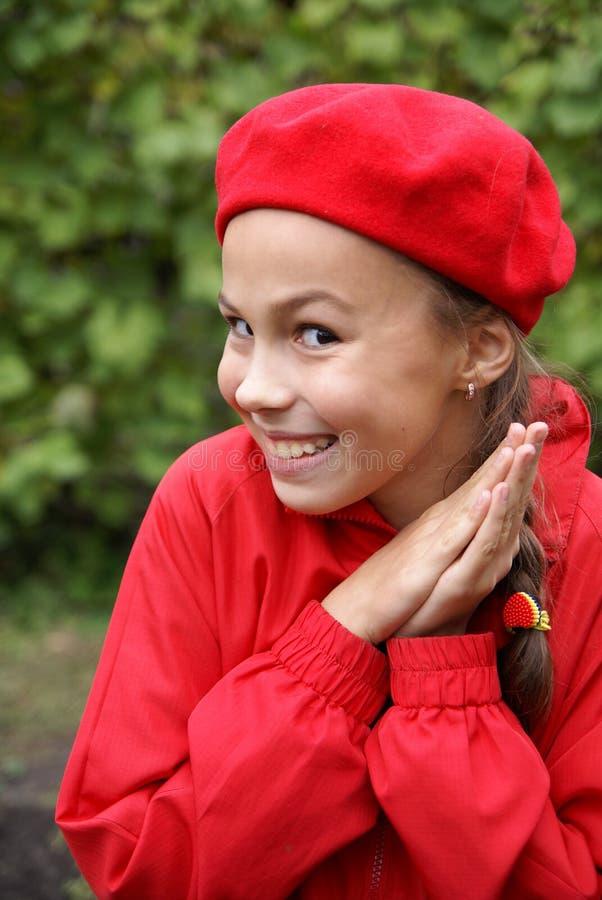 Menina no vermelho fotografia de stock royalty free