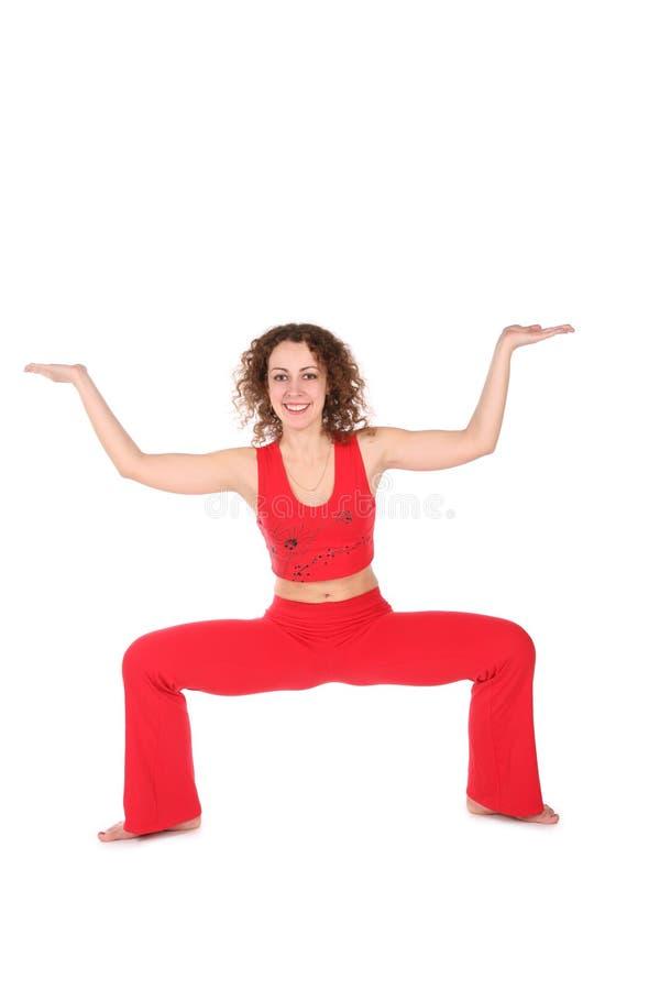 Menina no vermelho, um mais exercício da ioga imagem de stock royalty free
