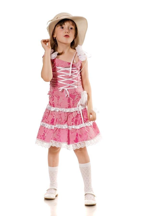 Menina no vestido e no chapéu cor-de-rosa foto de stock royalty free
