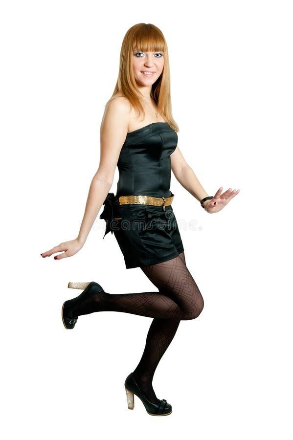 Menina no vestido preto isolado no branco imagem de stock royalty free