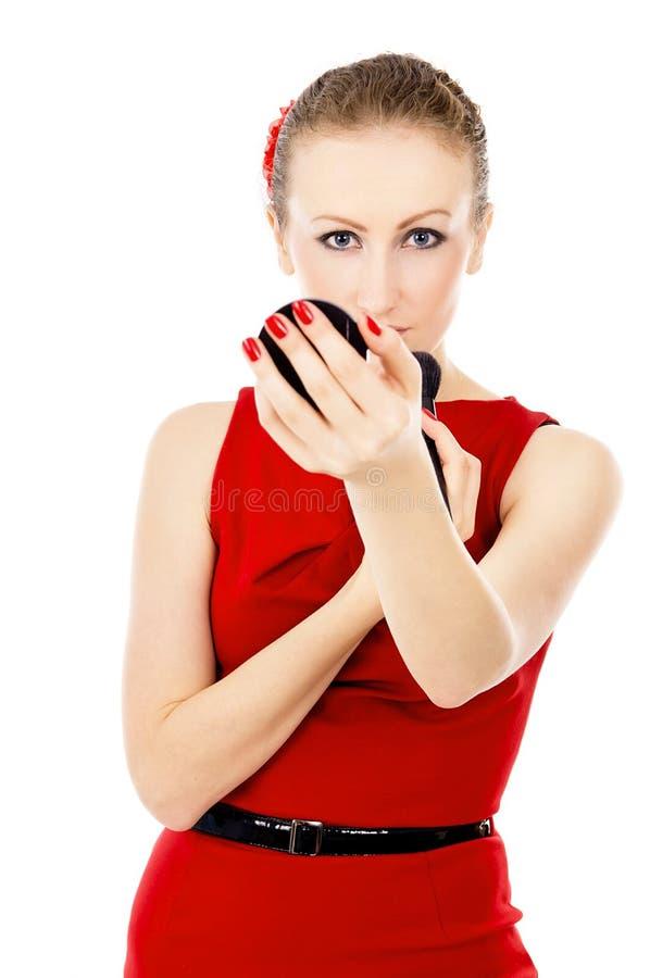 A menina no vestido vermelho, impor uma composição fotografia de stock