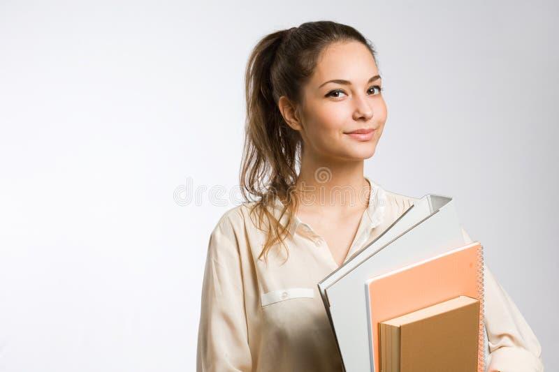 Menina nova à moda fresca do estudante. fotos de stock