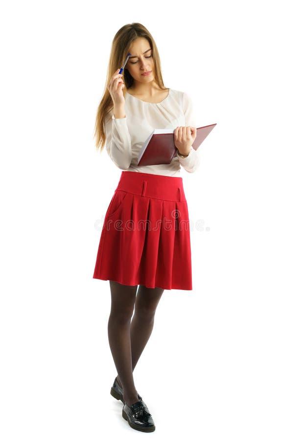 Menina nova bonito do estudante com livros fotos de stock royalty free