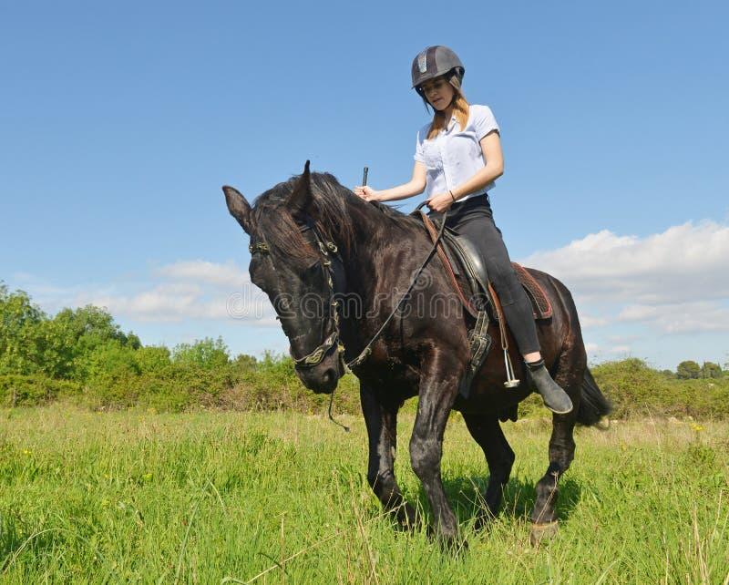 Menina nova da equitação imagem de stock royalty free