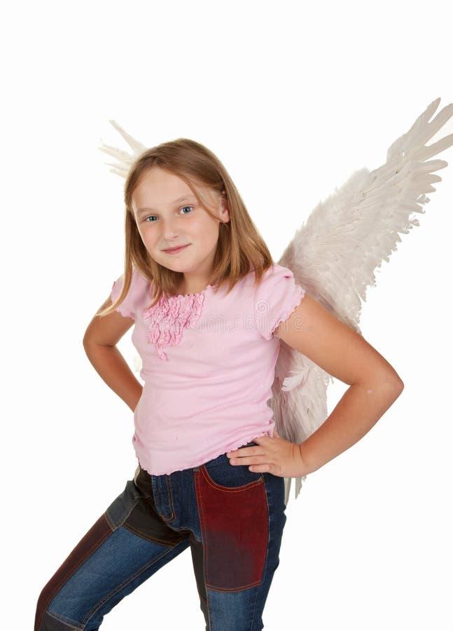 Menina nova do anjo com quadris das mãos imagens de stock royalty free
