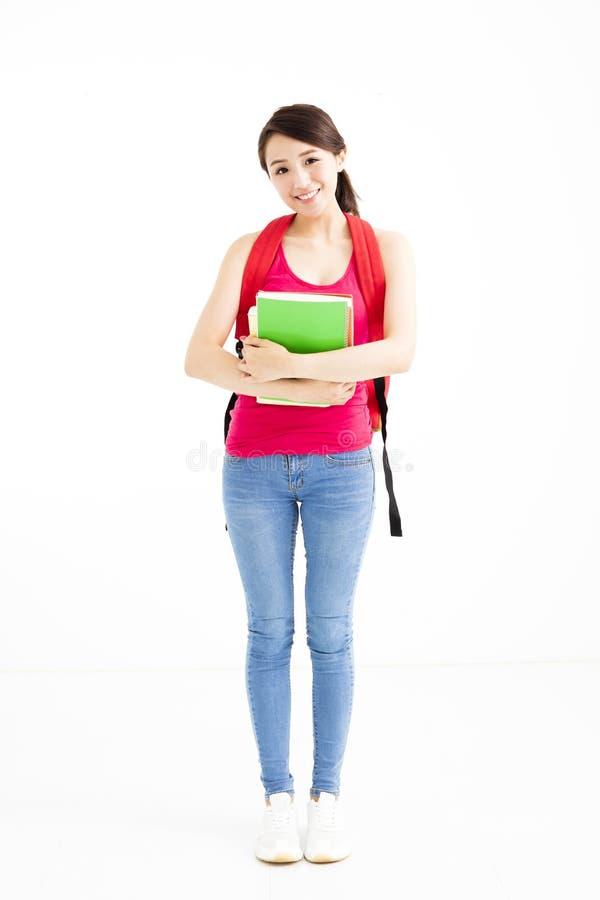 Menina nova do estudante com os livros isolados fotografia de stock