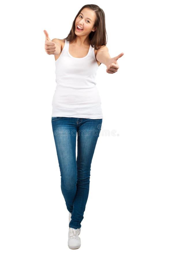 Menina ocasional feliz que mostra os polegares acima imagem de stock