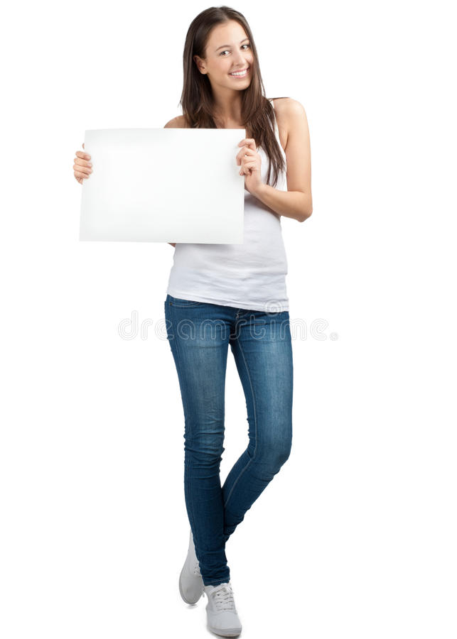 Menina ocasional que prende um quadro indicador em branco fotografia de stock royalty free