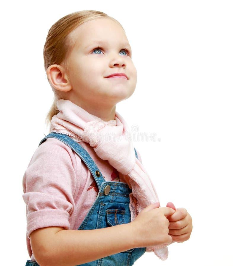 A menina olha acima fotos de stock