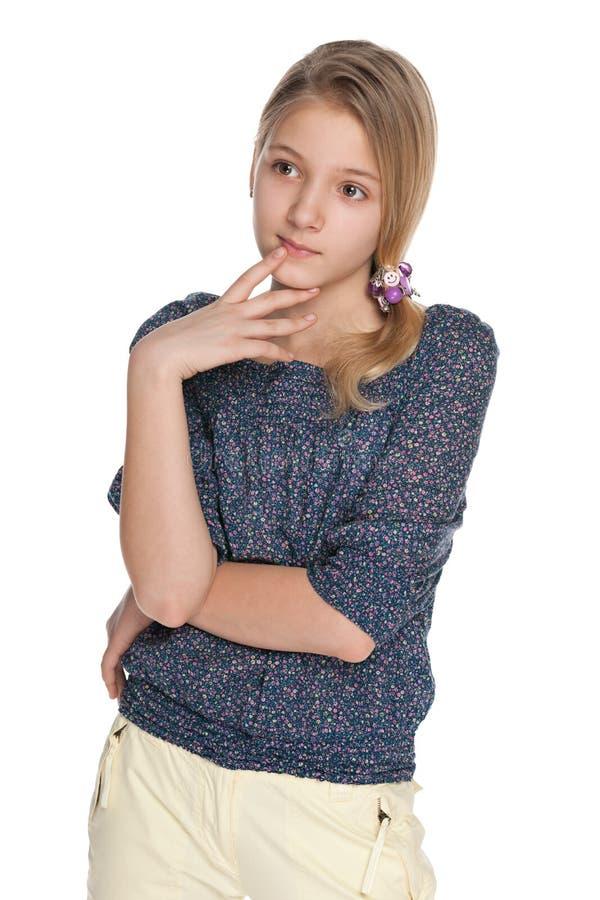 Menina pensativa do preteen no fundo branco fotografia de stock royalty free
