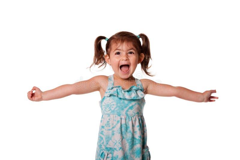 Menina pequena feliz ectática da criança fotografia de stock