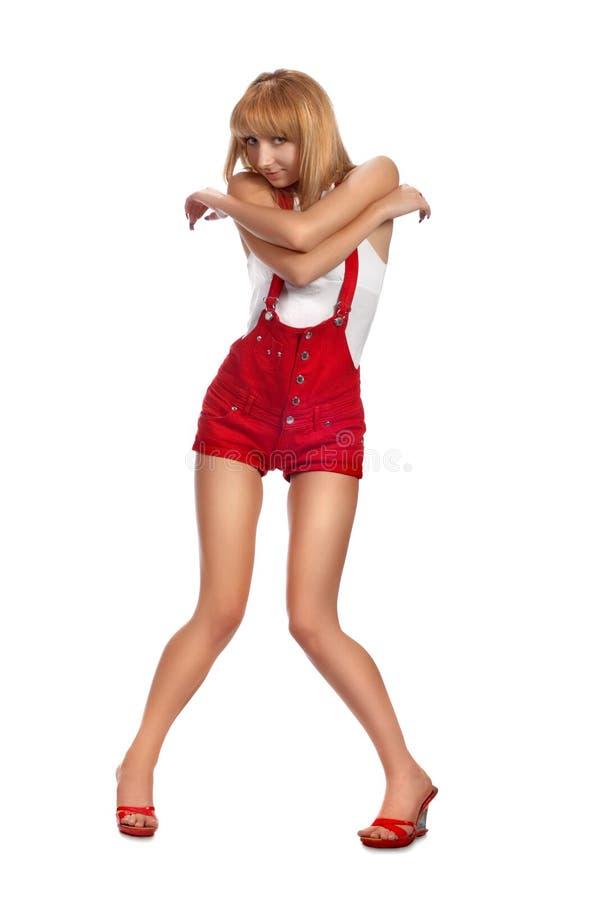 Menina Pin-acima em shorts vermelhos imagem de stock