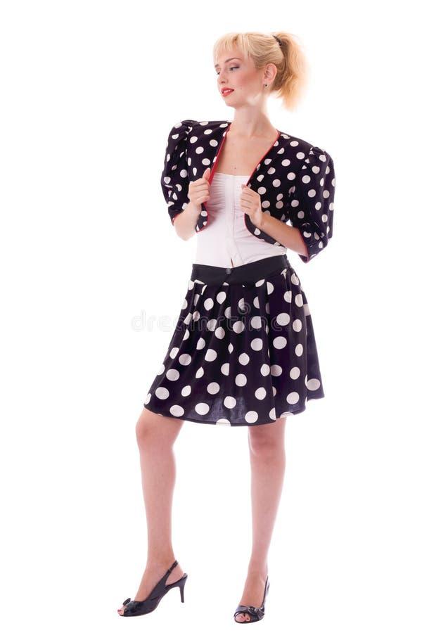 Menina Pin-acima no terno do ponto de polca imagem de stock