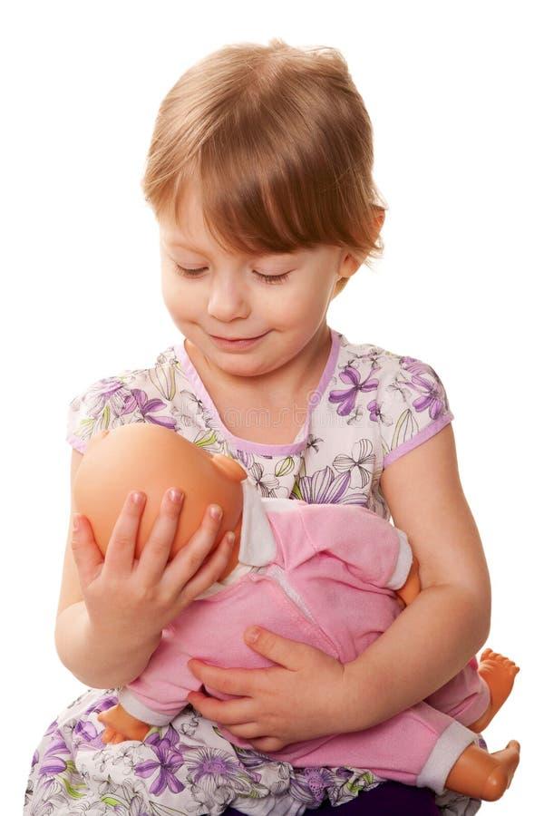 Download Menina Que Abraça Uma Boneca. Conceito Dos Cuidados. Foto de Stock - Imagem de face, emoção: 29841758