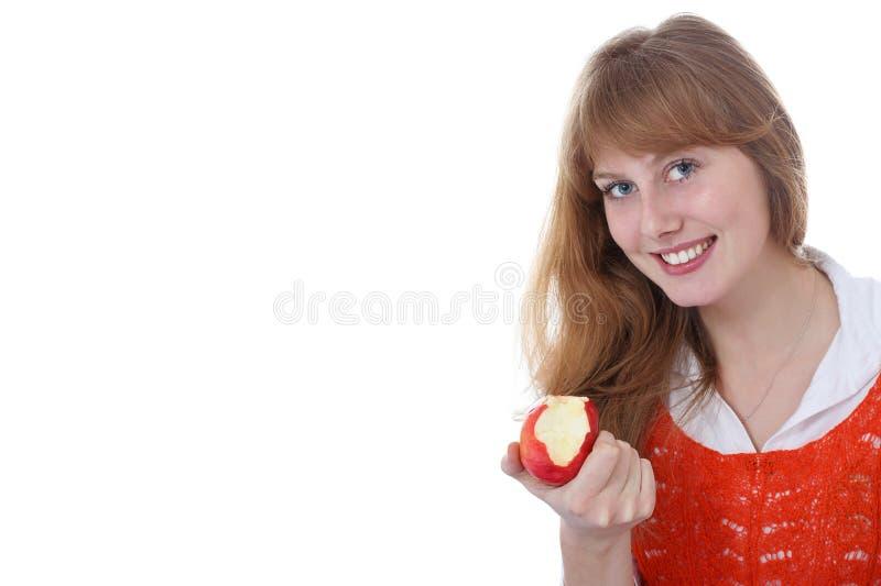 Menina que come a maçã madura fotos de stock