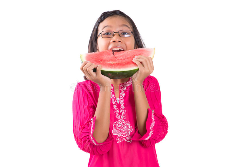 Menina que come a melancia II fotos de stock