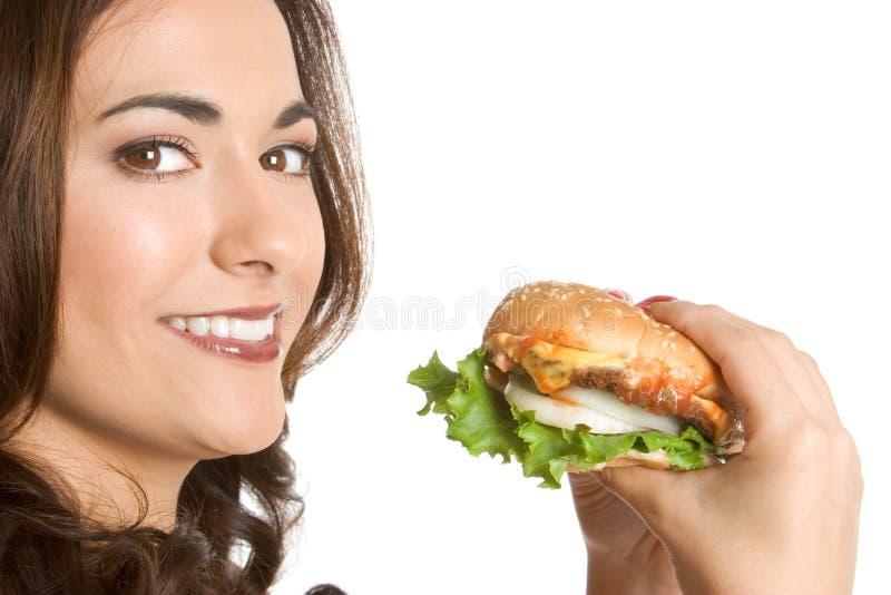 Menina que come o hamburguer foto de stock