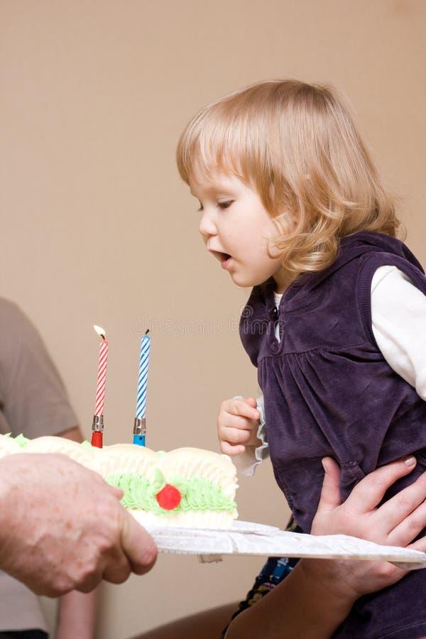 Menina que comemora o primeiro aniversário imagens de stock royalty free
