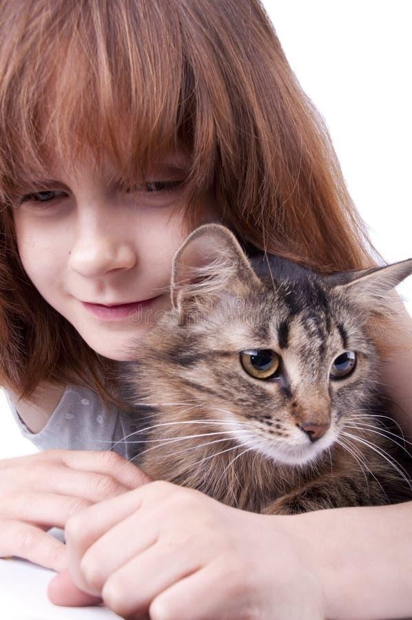 Menina que comunica-se com seu animal de estimação fotografia de stock royalty free