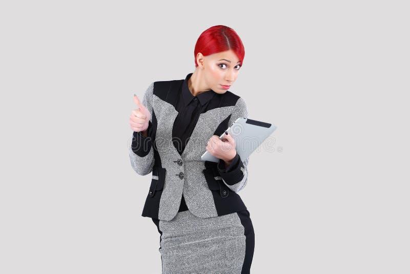 Menina que consulta a tabuleta na moda 5 imagens de stock royalty free