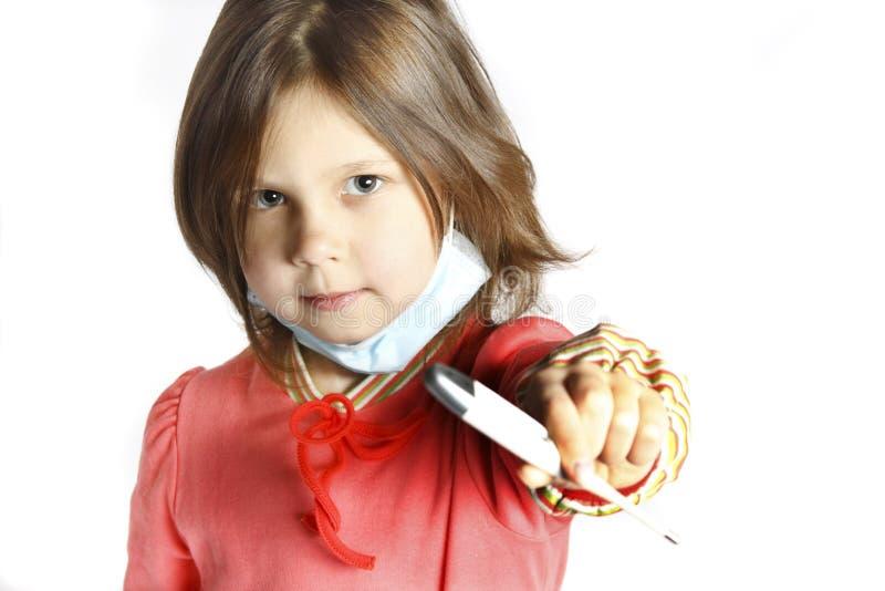Menina que desgasta uma máscara protetora fotos de stock royalty free