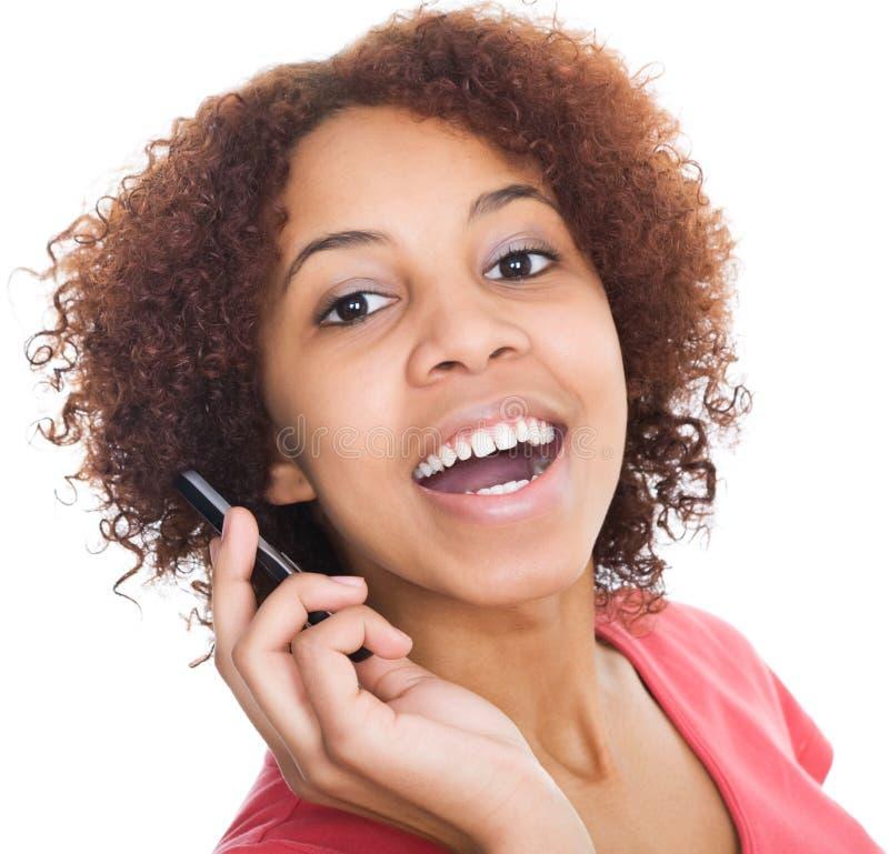 Menina que fala no telefone fotografia de stock royalty free