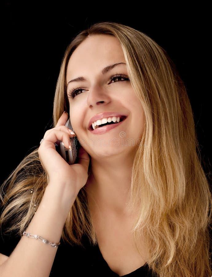 Menina que fala no telefone fotos de stock royalty free
