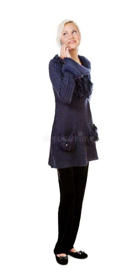 Menina que fala pelo telefone foto de stock
