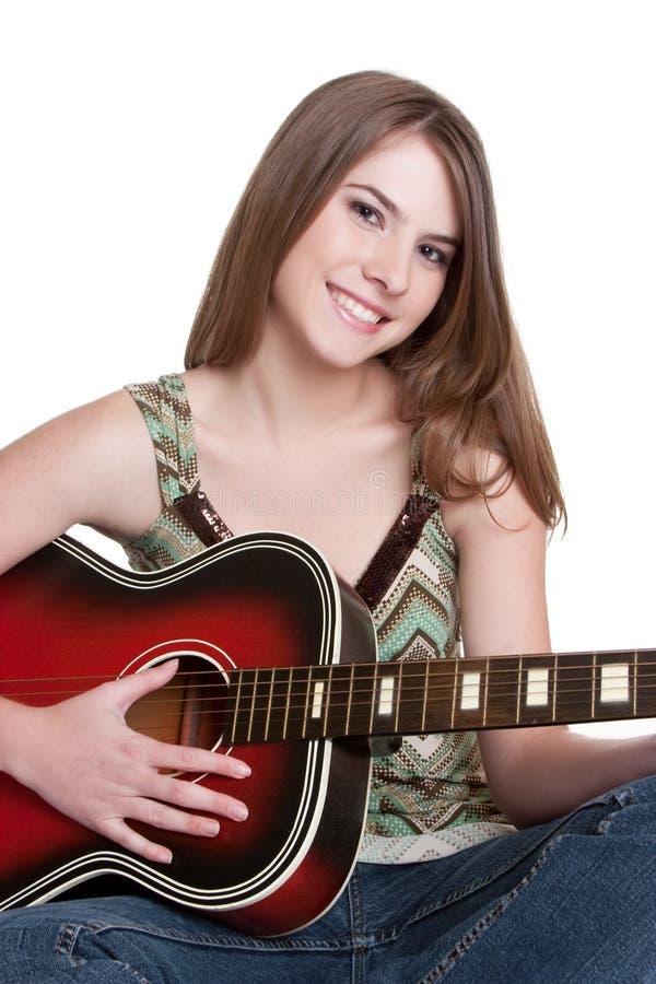 Menina que joga a guitarra fotografia de stock