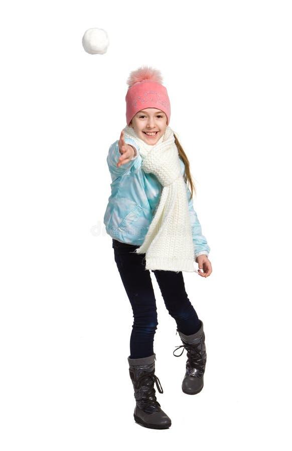 Menina que joga na neve fotos de stock
