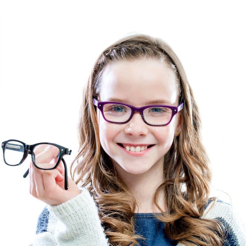 Menina que mantém vidros disponivéis imagem de stock royalty free