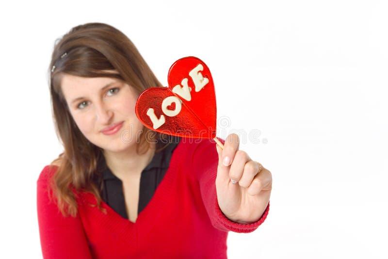 Menina que mostra o amor fotos de stock royalty free