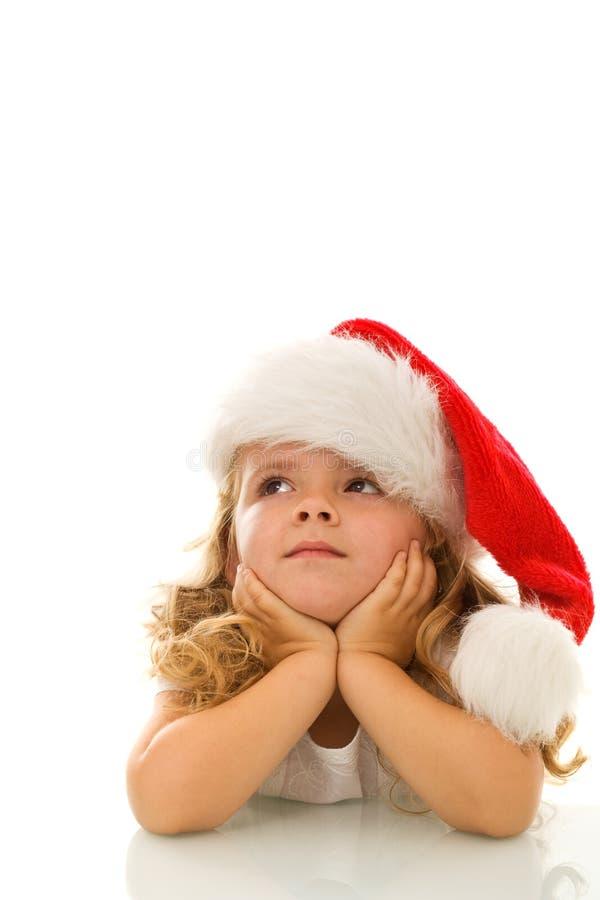 Menina que pensa sobre o Natal fotos de stock